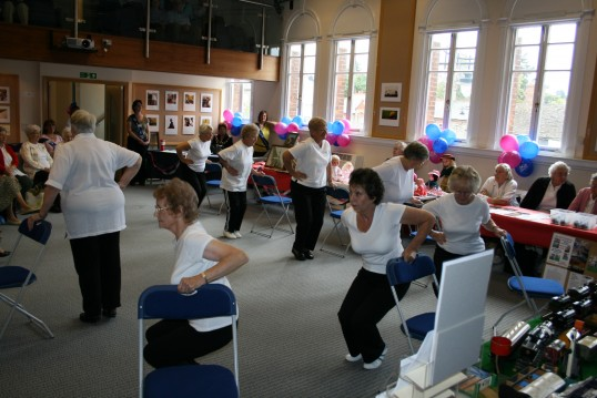 Ladies keep fit group performing at March Town Hall event, International Day of Older People. Attended by Chatteris Archive Group.