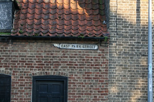 Street direction sign, located on front of house in Wood Street opposite South Park Street, Chatteris.