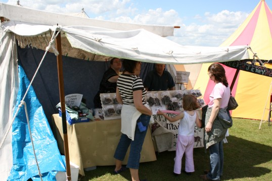 Cheese and other delights on this Stall, at Chatteris Medieval Festival, Furrowfields Park, Chatteris.