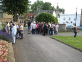 Crowd assemble, before start of Chatteris Community Archive Town Walk, at St Peter & St Pauls Church, for Medieval Festival