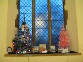 Christmas Trees on display for Christmas Tree Festival at Saint Peter & Saint Pauls church.Tree From Library on Left, Archive Tree on Right.