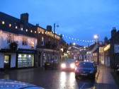 Chatteris Market Hill, street scene, cold and wet in December with Christmas lights setting the festive atmosphere.