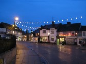Deserted High Street, Chatteris, late on a December night,with Christmas Lights to comfort the solitary lonely atmosphere.Time to light up a Strand