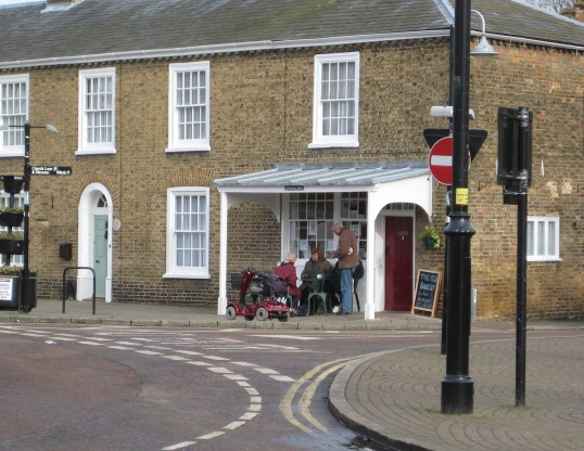The Old Bakery, Restaurant sited on corner of Market Hill & Church Lane, Chatteris.Customers sitting outside, watching Chatteris go by.. Old Bakery