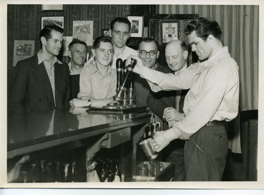 Freddie Mills pulling a pint at the George Hotel, Chatteris.See following caption for details.Photograph courtesy of Wisbech and Fenland Museum.