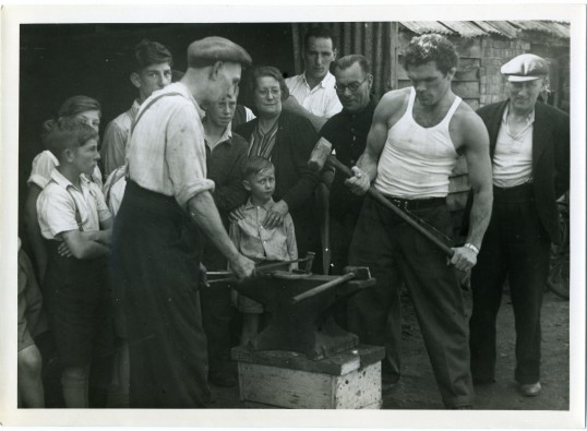 Freddie Mills outside Eric Boon fathers Blacksmith shop,taken on a visit to Chatteris in 1947.Photograph courtesy of Wisbech and Fenland Museum.