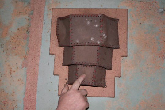 Wall lantern shade held in postion in old Empress Cinema, Chatteris.See text for more information.