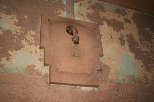 Wall light surround without shade, in old Empress Cinema, Chatteris.See text for more information.