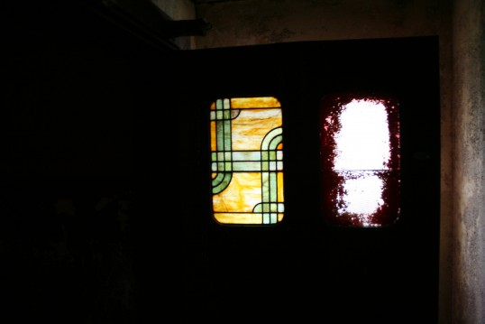 Art Deco leaded light in door at old Empress Cinema, Chatteris.See text for more information.