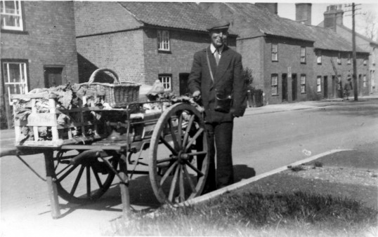 E. Knightly selling vegetables from his barrow in Chatteris.