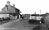 "Ferry Toll gates and The Blue Ball public house. Sepia Postcard by H Coates of Wisbech  Milestone to right reads""To Wisbech 22 miles"""