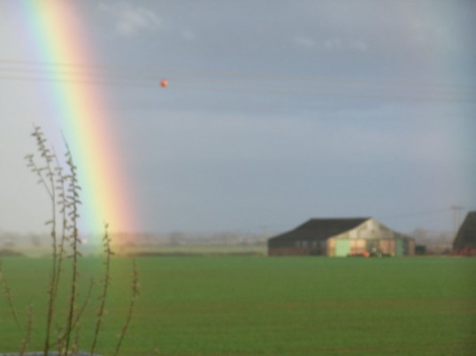 Tithe barn with rainbow