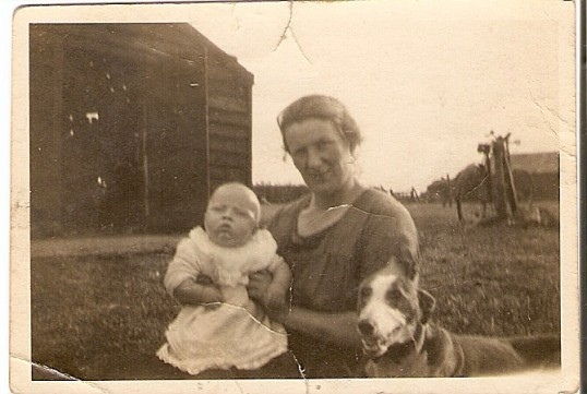 Emily Bishop holding relative's baby, at 5 Beezlings Farm, Chatteris.