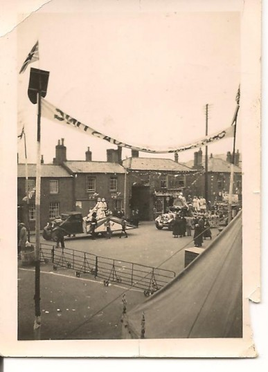 Chatteris Ox Roast. East Park Street, junction with Saint Martins Road. Decorated float of King & Queen?