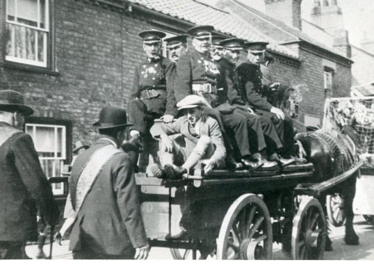 Firemen on a horse drawn engine in a  parade in Chatteris. Possibly Hospital Sunday. Photo from Stuart Stacey Collection