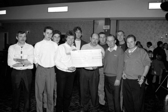 Group  of men display cheque presentation-Stuart Stacey Collection