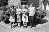 School Pupils hold shield and cup trophy outside -Stuart Stacey Collection