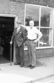 Men  outside shop in High Street Chatteris-Stuart Stacey Collection