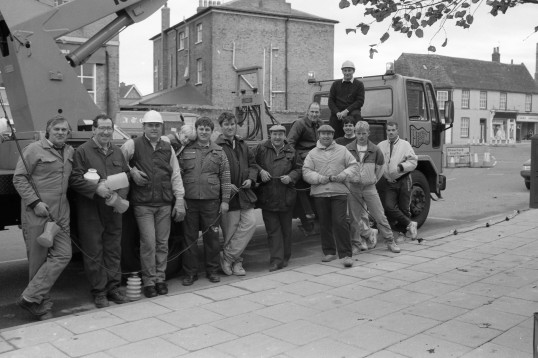 Men  beside lorry ready to erect Chatteris Christmas Lights-Stuart Stacey Collection