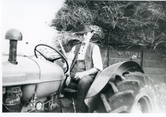 Farmer on tractor-Stuart Stacey Collection