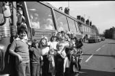 Families  prepare to board coach trip -Stuart Stacey Collection