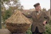 Man with mini hay stack.