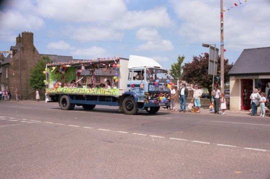Graves and Graves lorry with carnival float decoration on High street
