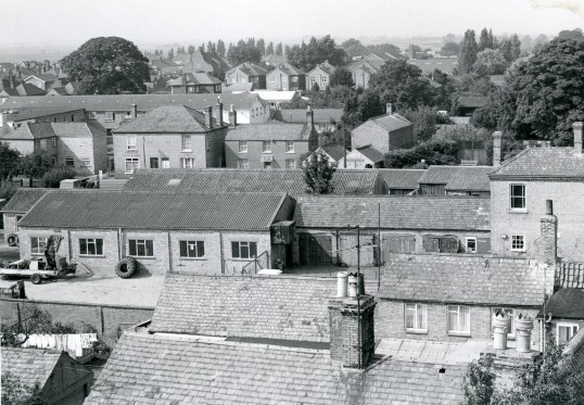 View across Crawley's Garage toward Huntingdon Rd. Summers Bakery in background.