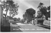 Looking down Mill End Rd with The Red Lion Pub on the right. Courtesy of The Cambridgeshire Collection.
