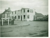 Demolition of the old Chequers Public House in Cherry Hinton with the new Chequers behind (courtesy of Cambridgeshire Collection)