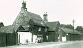 Hall Farm, Cherry Hinton High Street now TSB Lloyds Bank.  The children are on the stile to Love Lane (courtesy of the Cambridge Antiquarian Society)