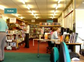 The interior of the lending library in Cherry Hinton High Street showing both bookshelves and computers (Photograph Norman Daniels)