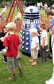 Some young visitors are introduced to the Festival Dalek (Photo: Norman Daniels)