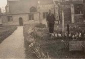 St Andrew's Church, Chesterton, in the spring with Mr R. Rayner, churchgoer, bellringer and (?) caretaker