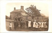 1900.  approx  Coveney school children and the school 'bus' (donkey and cart).