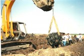 1996.  Excavation of Lancaster bomber from the field near Coveney. Remains of one of the engines being brought up.