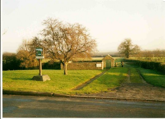 2000 1st Jan  Coveney village green, pound and sign on the dawn of the new millennium.