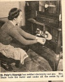 1946.  Mrs Beale lighting her parafin cooking stove