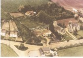 1958.  Aerial view of  Coveney school, church, rectory, Baracks and village centre.