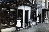 Mrs. H Lofts, Nee Nichols, outside her fathers shop. in Carter Street Fordham.Photo Mr John Lofts.