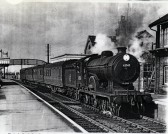 Train in fordham Station.A Claud Hamilton 4-4-0 with LNER Coaches.