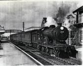 Pasenger train leaving Fordham Station bound for Cambridge.