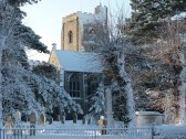 Fordham Church framed by snow laden trees. Jan 2010