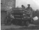 Great Abington - Land Settlement Association. Arthur Frampton and his son Neil with Scotney truck and LSA boxes.