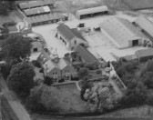 Great Abington - Land Settlement Association. Aerial photograph of the estate farm, New House Farm, showing farmhouse and yard.
