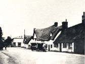 Great Abington - High Street. Forge on right, demolished in 1960s, still operating after WW2. Village shop in background at junction with Linton Road.
