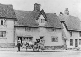 Linton - Bakery of Herbert Powell at top of High Street, delivery cart in front of 17th century house and shop. Owner and wife in doorways.