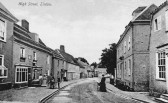 Linton - Post Office on the left with the mail handcart outside.  On the right the 18th century former Bull Inn.