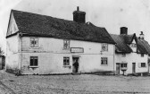 Linton - The White Hart Inn at the top of the High Street when Hawkes Brewery of Stortford bought the premises.  Inn demolished in 1911.