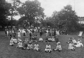 Linton - Infant school children in Dr. Palmer's garden at Richmonds for the annual Flower Show for children which he started in 1915.